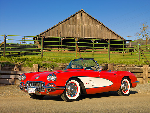 VET 03 RK0735 01 © Kimball Stock 1960 Chevrolet Corvette Red With White Cove 3/4 Front View On Gravel By Farm