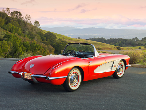 VET 03 RK0740 01 © Kimball Stock 1960 Chevrolet Corvette Red With White Cove 3/4 Rear View On Road In Hills