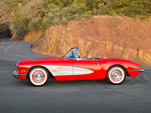 VET 03 RK0741 01 © Kimball Stock 1960 Chevrolet Corvette Red With White Cove Profile View On Road In Hills