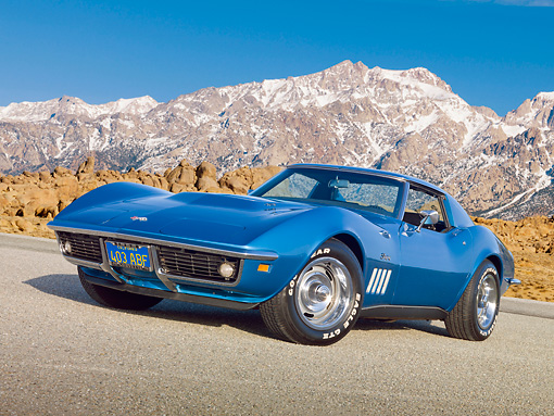 VET 03 RK0751 01 © Kimball Stock 1969 Chevrolet Corvette Stingray Blue 3/4 Front View On Pavement By Snowy Peaks