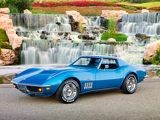 VET 03 RK0755 01 © Kimball Stock 1969 Chevrolet Corvette Stingray Blue 3/4 Front View On Pavement By Waterfalls