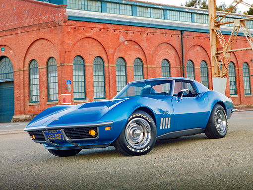 VET 03 RK0757 01 © Kimball Stock 1969 Chevrolet Corvette Stingray Blue 3/4 Front View On Pavement By Brick Building