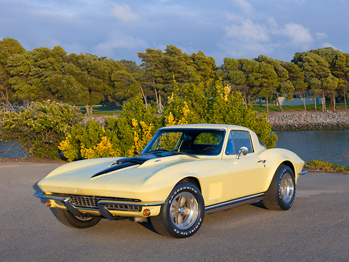 VET 03 RK0767 01 © Kimball Stock 1967 Chevrolet Corvette Yellow 3/4 Side View On Pavement By Pond And Trees