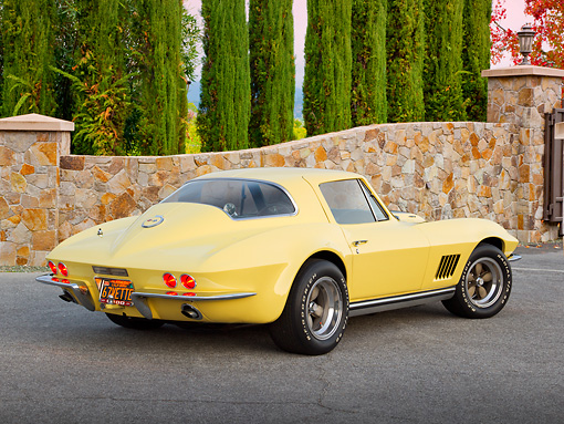 VET 03 RK0769 01 © Kimball Stock 1967 Chevrolet Corvette Yellow 3/4 Rear View On Pavement By Stone Wall And Trees