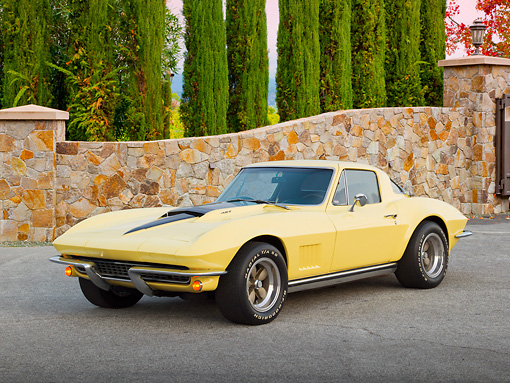 VET 03 RK0770 01 © Kimball Stock 1967 Chevrolet Corvette Yellow 3/4 Front View On Pavement By Stone Wall And Trees