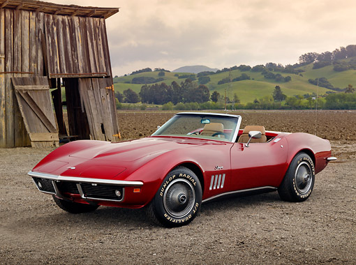 VET 03 RK0793 01 © Kimball Stock 1969 Chevrolet Corvette Roadster Red 3/4 Front View On Dirt By Old Wooden Shed