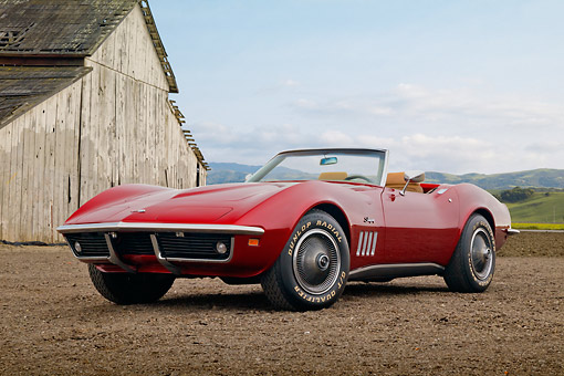 VET 03 RK0796 01 © Kimball Stock 1969 Chevrolet Corvette Roadster Red 3/4 Front View On Dirt By Old Wooden Shed