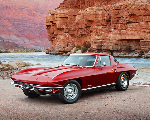 VET 03 RK0797 01 © Kimball Stock 1967 Chevrolet Corvette Burgundy 3/4 Front View On Dirt By Water And Red Rock