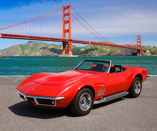 VET 03 RK0799 01 © Kimball Stock 1969 Chevrolet Corvette Monza Red 3/4 Front View On Pavement By Golden Gate Bridge