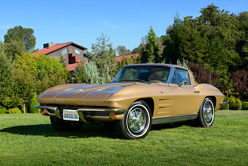 VET 03 RK0800 01 © Kimball Stock 1963 Chevrolet Corvette Saddle Tan 3/4 Front View On Grass By Trees