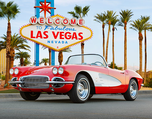 VET 03 RK0801 01 © Kimball Stock 1961 Chevrolet Corvette Red 3/4 Front View On Pavement By Las Vegas Sign