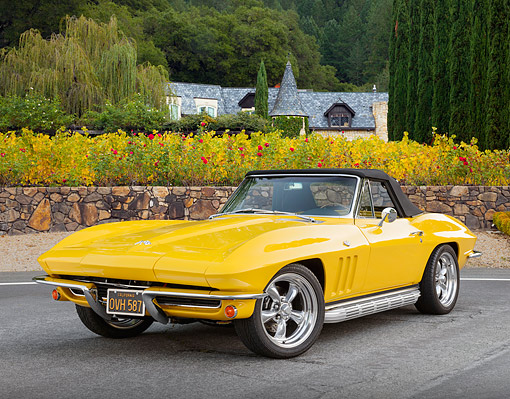 VET 03 RK0804 01 © Kimball Stock 1965 Chevrolet Corvette Convertible Yellow 3/4 Front View On Pavement By Mansion