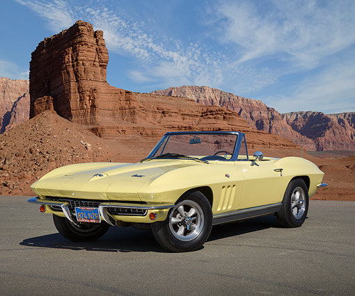 VET 03 RK0805 01 © Kimball Stock 1966 Chevrolet Corvette Roadster Sunfire Yellow 3/4 Front View On Pavement In Desert