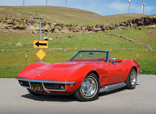 VET 03 RK0808 01 © Kimball Stock 1968 Chevrolet Corvette Roadster Red 3/4 Front View On Pavement By Windmills