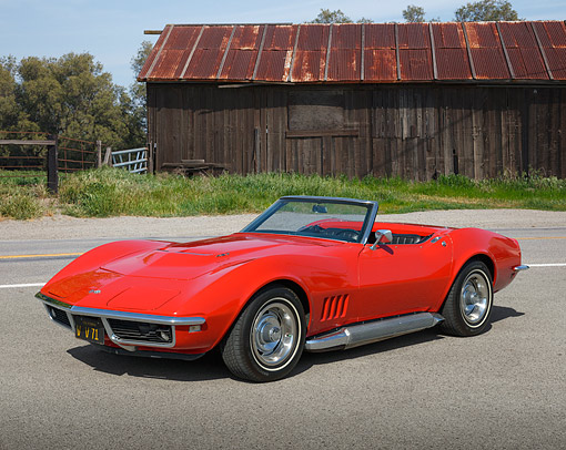 VET 03 RK0809 01 © Kimball Stock 1968 Chevrolet Corvette Roadster Red 3/4 Side View On Road By Wooden Shed