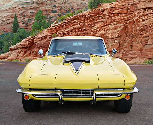 VET 03 RK0813 01 © Kimball Stock 1967 Chevrolet Corvette Coupe Yellow Front View On Pavement By Red Rock