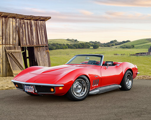 VET 03 RK0819 01 © Kimball Stock 1969 Chevrolet Corvette Stingray Red 3/4 Front View On Pavement By Field And Wooden Shed
