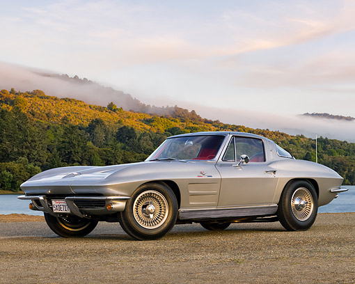 VET 03 RK0834 01 © Kimball Stock 1963 Chevrolet Corvette Stingray Sport Coupe Silver 3/4 Side View On Pavement