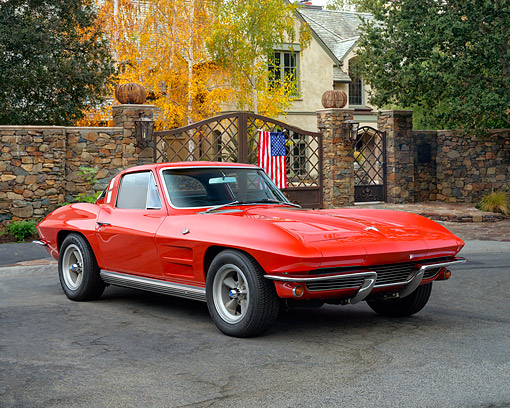 VET 03 RK0837 01 © Kimball Stock 1964 Chevrolet Corvette Stingray Red 3/4 Front View On Pavement By Mansion