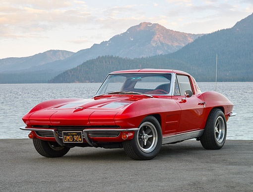 VET 03 RK0843 01 © Kimball Stock 1963 Chevrolet Corvette Sting Ray Split-Window Custom Tires Red 3/4 Front View On Pavement By Mountain Lake