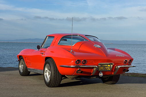 VET 03 RK0844 01 © Kimball Stock 1963 Chevrolet Corvette Sting Ray Split-Window Custom Tires Red 3/4 Rear View On Pavement By Lake