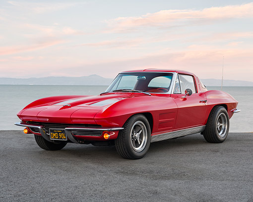 VET 03 RK0846 01 © Kimball Stock 1963 Chevrolet Corvette Sting Ray Split-Window Custom Tires Red 3/4 Front View On Pavement By Lake