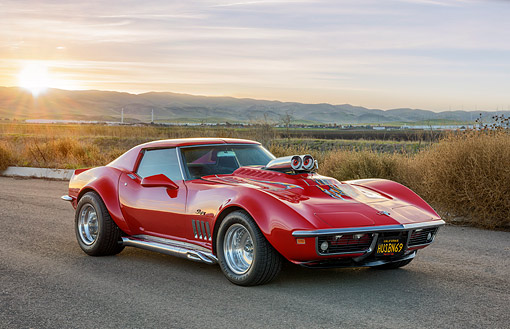 VET 03 RK0860 01 © Kimball Stock 1969 Chevrolet Corvette Stingray Red With Custom Graphics 3/4 Front View On Desert Road At Sunset