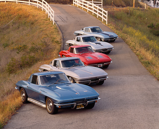 VET 03 RK0072 04 © Kimball Stock 1963-1967 Chevrolet Corvettes Parked All In A Row 3/4 Side View On Pavement