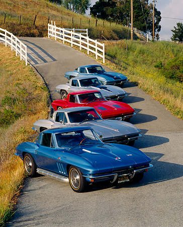 VET 03 RK0073 15 © Kimball Stock 1963-1967 Chevrolet Corvettes On Pavement Hill