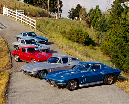 VET 03 RK0074 12 © Kimball Stock 1963-1967 Chevrolet Corvettes In A Row On Pavement Hill