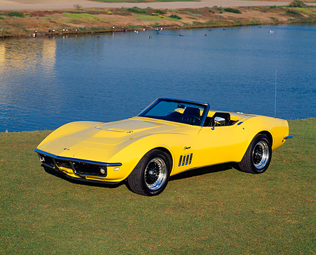 VET 03 RK0096 01 © Kimball Stock 1969 Chevrolet Corvette 427 L88 Yellow 3/4 Front View On Grass By Water