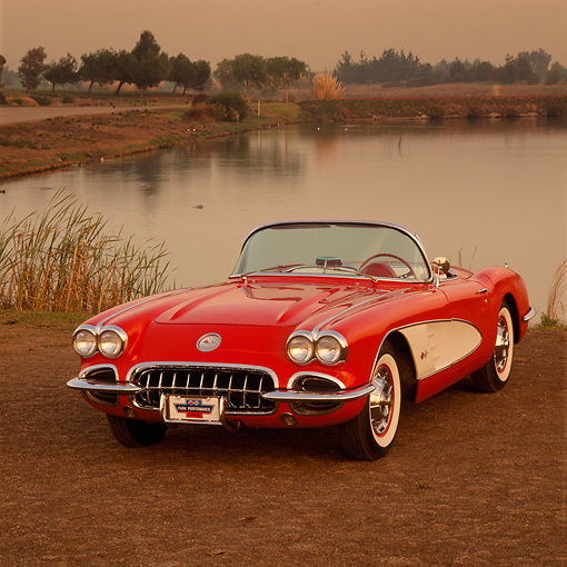 VET 03 RK0145 05 © Kimball Stock 1960 Chevrolet Corvette  Convertible Red And White 3/4 Front View On Grass By Water