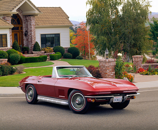 VET 03 RK0196 02 © Kimball Stock 1967 Chevrolet Corvette 327 Convertible Burgundy 3/4 Front View On Pavement By House