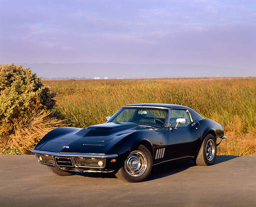 VET 03 RK0204 01 © Kimball Stock 1969 Chevrolet Corvette Stingray Black 3/4 Front View On Pavement By Tall Grass