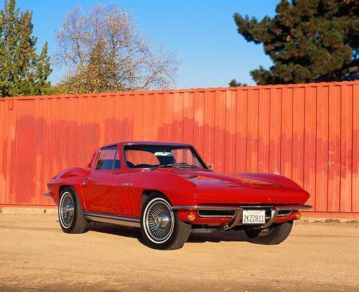 VET 03 RK0320 07 © Kimball Stock 1965 Chevrolet Corvette Coupe Fuel Injected Red 3/4 Front View On Dirt
