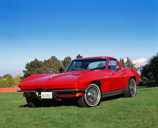VET 03 RK0322 05 © Kimball Stock 1965 Chevrolet Corvette Coupe Fuel Injected Red Low 3/4 Front View On Grass