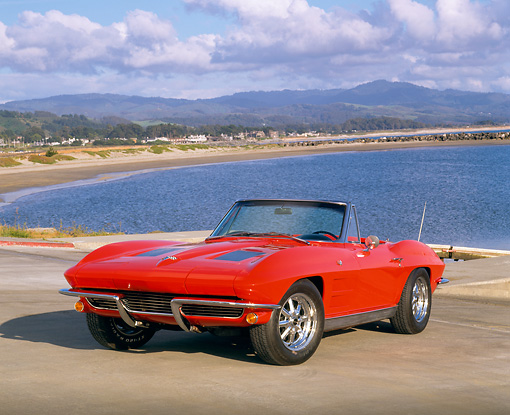 VET 03 RK0357 05 © Kimball Stock 1963 Chevrolet Corvette 327 Convertible Red 3/4 Front View On Pavement By Water