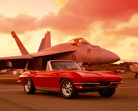VET 03 RK0363 09 © Kimball Stock 1963 Chevrolet Corvette 327 Convertible Red Low 3/4 Front View On Pavement By Airplane Filtered
