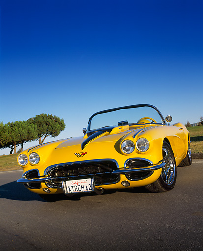 VET 03 RK0369 04 © Kimball Stock 1962 Chevrolet Corvette Convertible Extreme Yellow Low 3/4 Front View On Pavement Trees Blue Sky