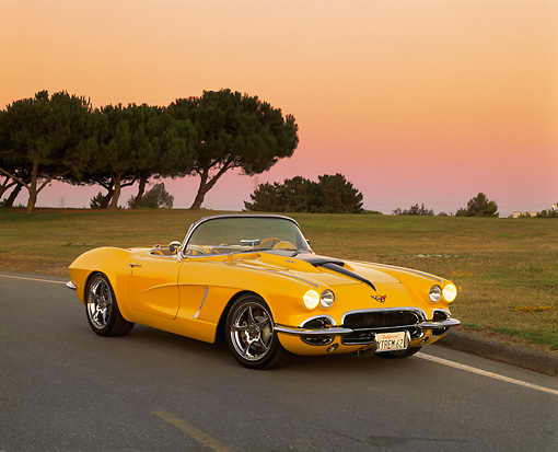 VET 03 RK0378 01 © Kimball Stock 1962 Chevrolet Corvette Extreme Convertible Yellow 3/4 Front View On Road