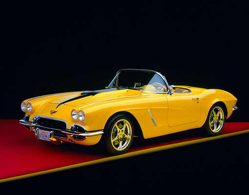 VET 03 RK0384 05 © Kimball Stock 1962 Extreme Corvette Convertible Yellow 3/4 Front View On Red Floor Yellow Line Studio