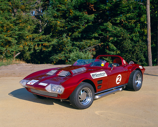 VET 03 RK0389 04 © Kimball Stock 1963 Chevrolet Corvette Grand Sport Replica Red 3/4 Front View On Sand By Trees