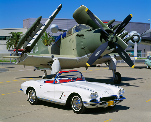VET 03 RK0412 04 © Kimball Stock 1962 Chevrolet Corvette Convertible White 3/4 Front View On Pavement By Military Airplane