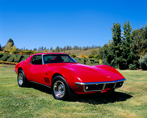 VET 03 RK0447 03 © Kimball Stock 1968 Chevrolet Corvette Red 3/4 Front View On Grass