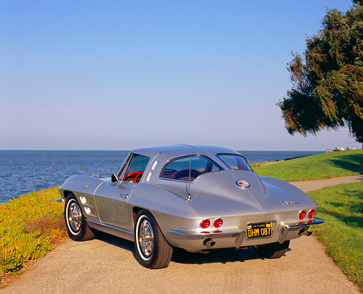 VET 03 RK0455 04 © Kimball Stock 1963 Chevy Corvette Split Window Silver 3/4 Rear View On Pavement By Water