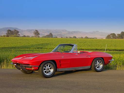 VET 03 RK0501 01 © Kimball Stock 1963 Chevrolet Corvette Convertible Red 3/4 Front View On Pavement