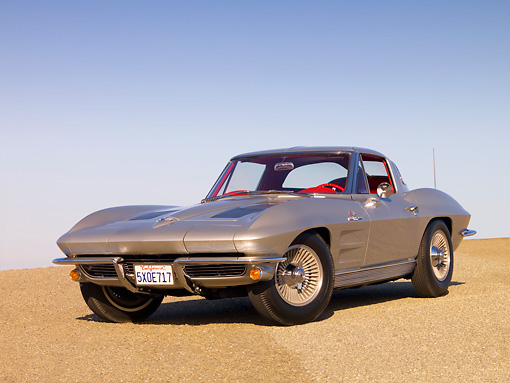 VET 03 RK0514 01 © Kimball Stock 1963 Chevrolet Corvette Sting Ray Sport Coupe Silver Low 3/4 Front View On Pavement