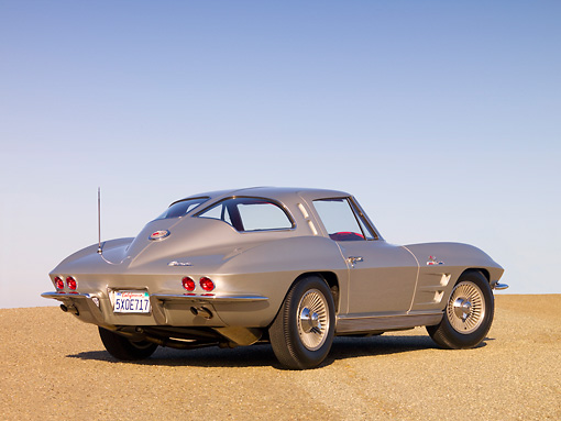 VET 03 RK0515 01 © Kimball Stock 1963 Chevrolet Corvette Sting Ray Sport Coupe Silver Low 3/4 Rear View On Pavement