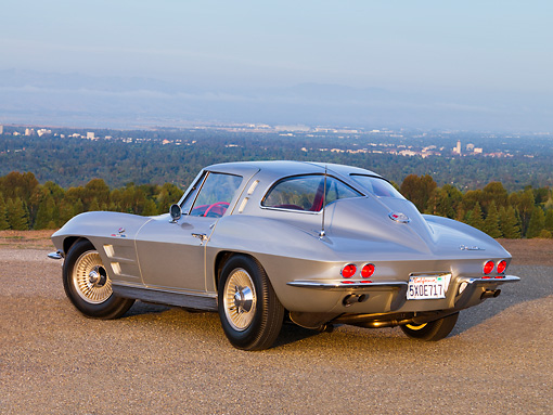 VET 03 RK0518 01 © Kimball Stock 1963 Chevrolet Corvette Sting Ray Sport Coupe Silver Low 3/4 Rear View On Pavement