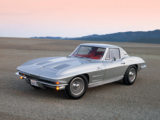 VET 03 RK0521 01 © Kimball Stock 1963 Chevrolet Corvette Sting Ray Sport Coupe Silver 3/4 Rear View On Pavement